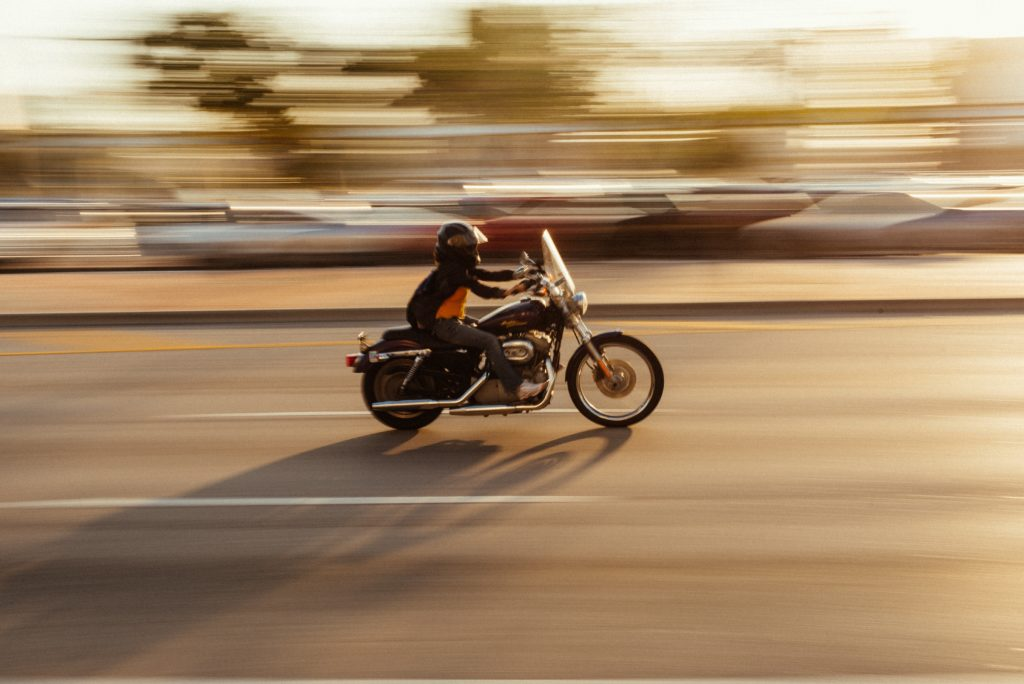 A motorcyclist speeding on a highway